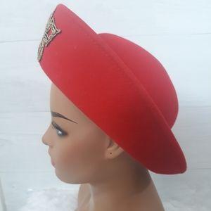 Vintage red felt medallion hat